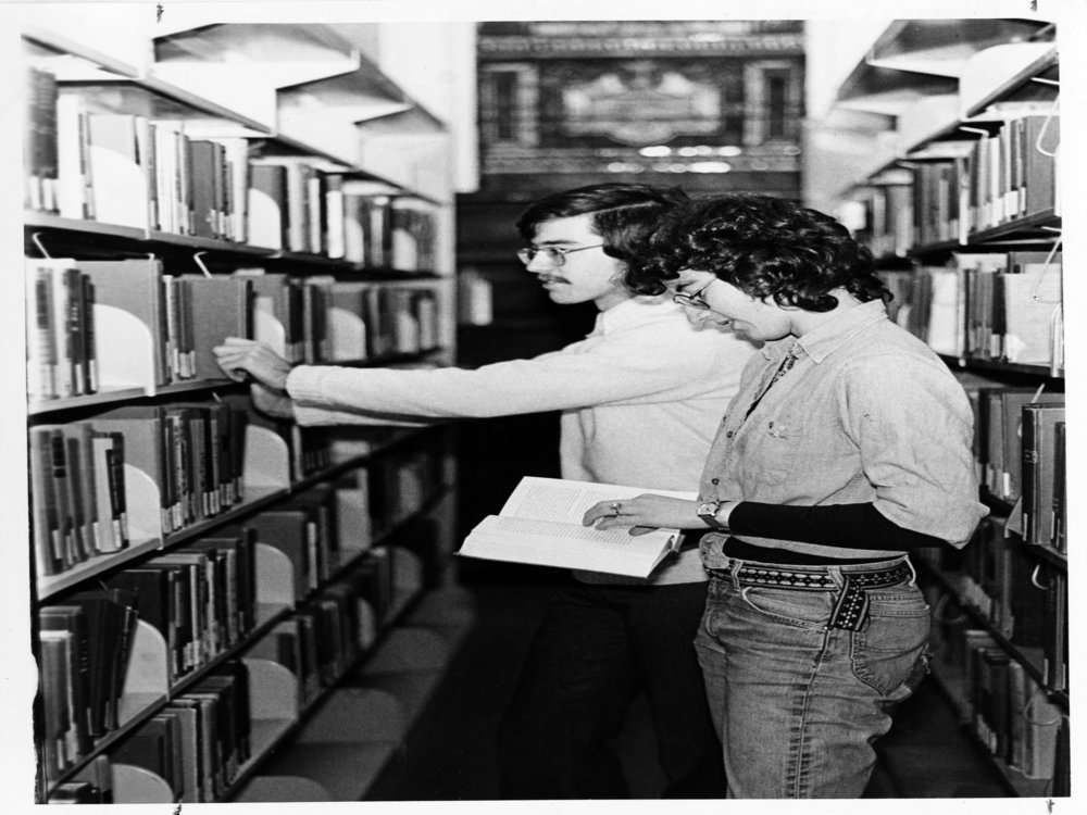 two unidentified students in the library vintage image