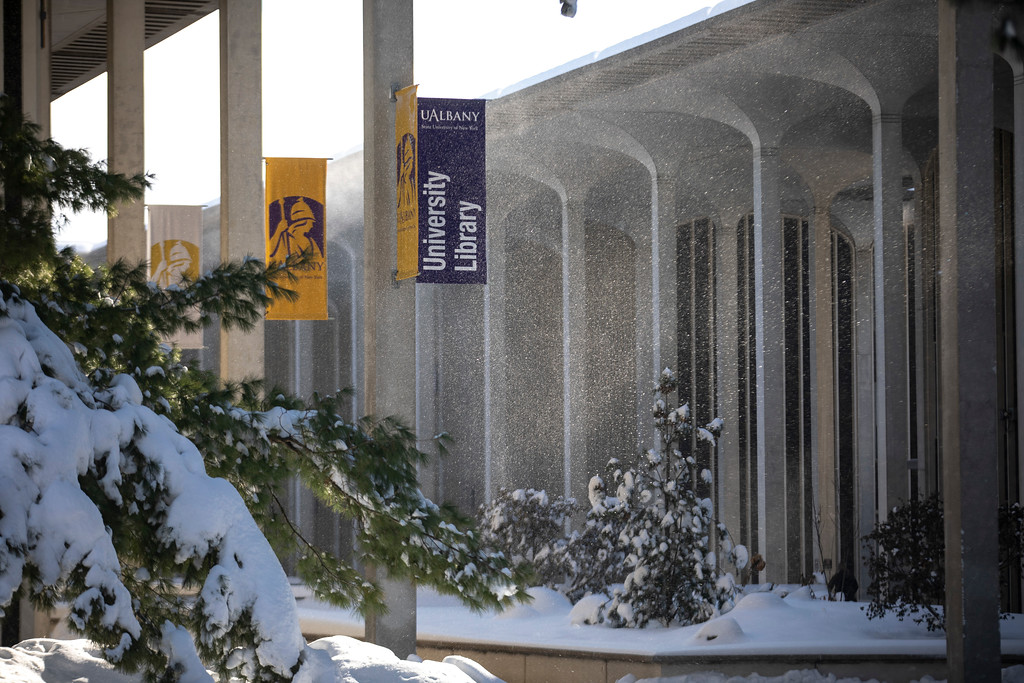 Snow falls on University Library