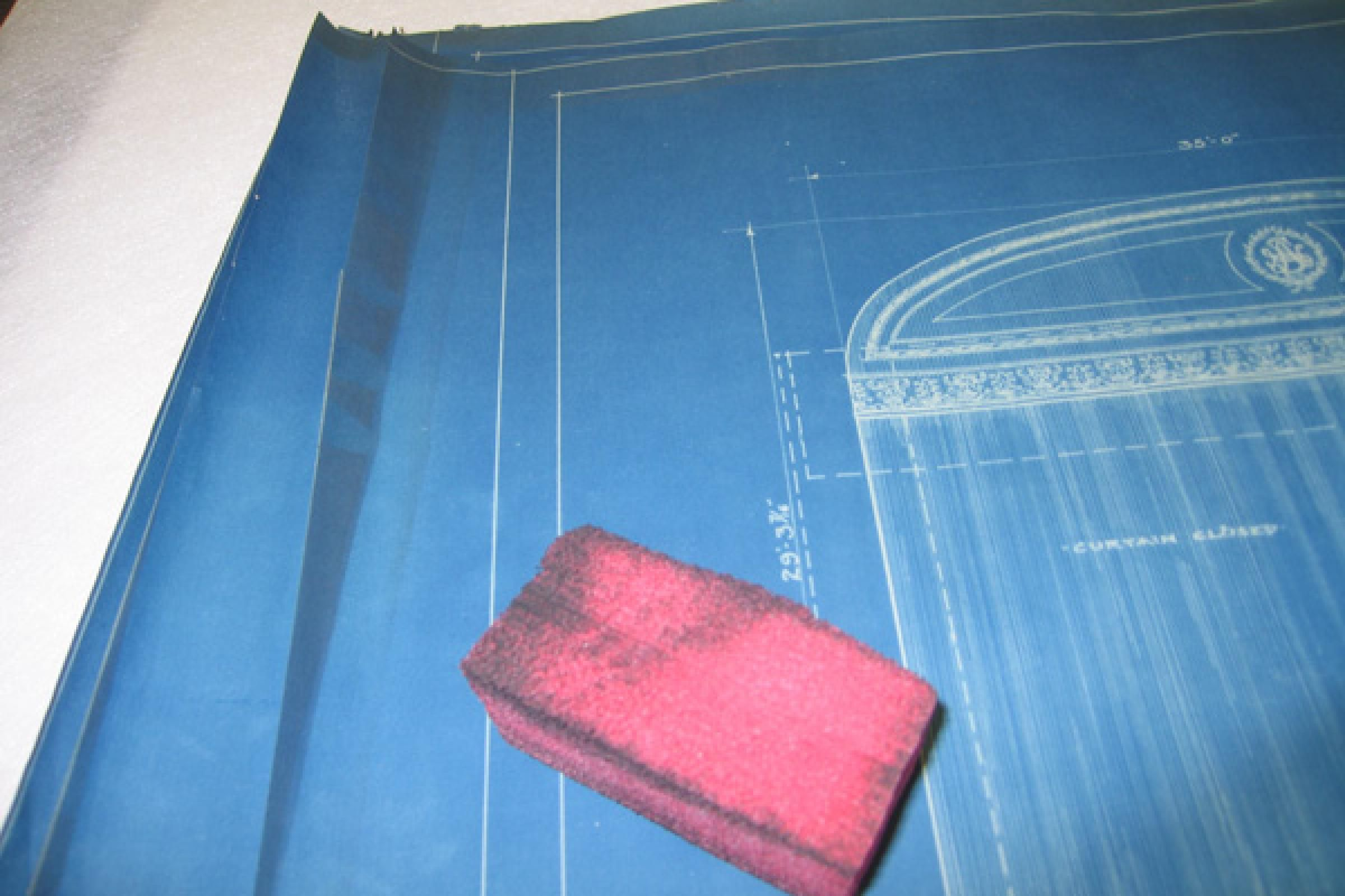 Smoke sponge and partially-cleaned blueprint