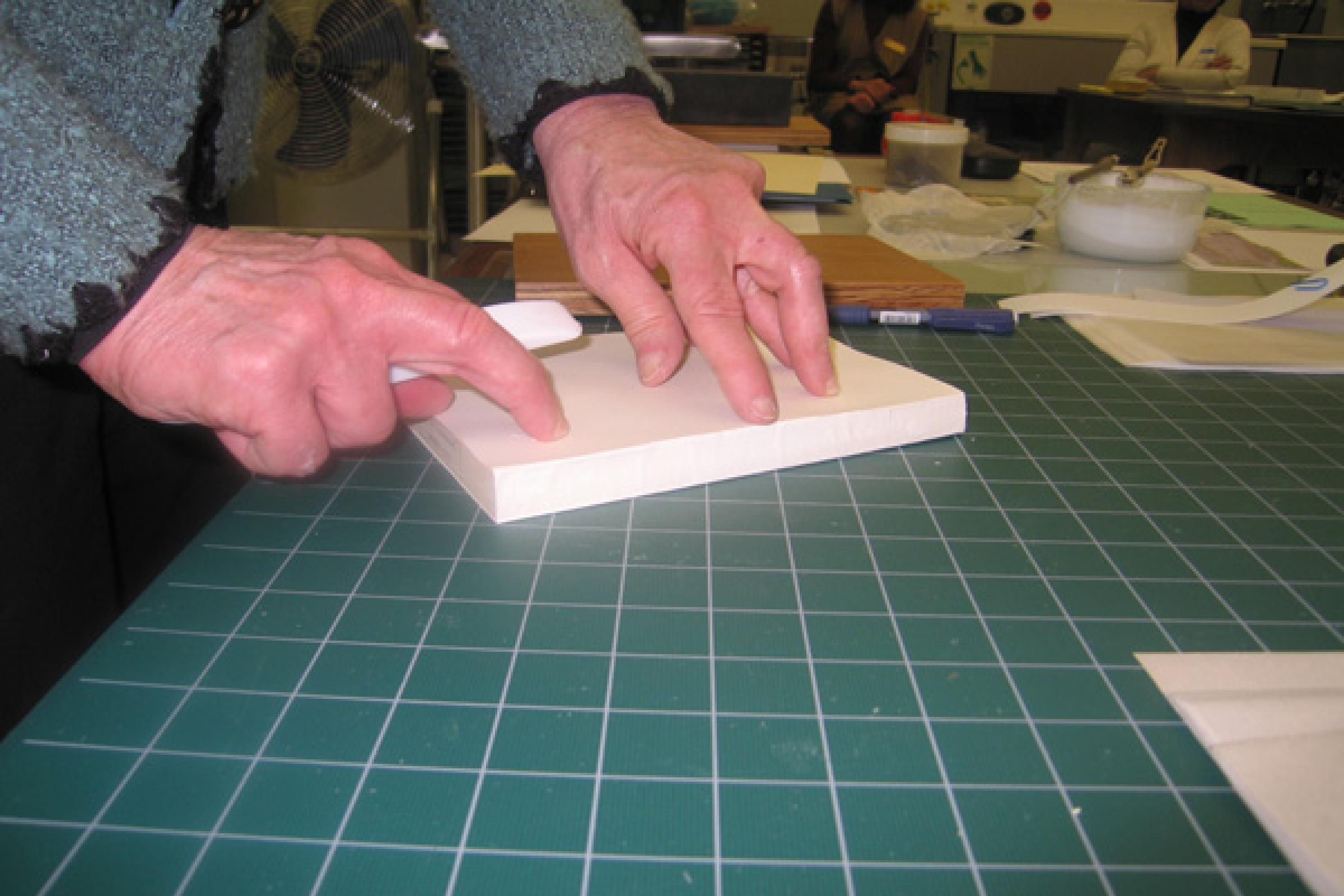 A quick demonstration on fitting endpapers before students attempt the procedure...