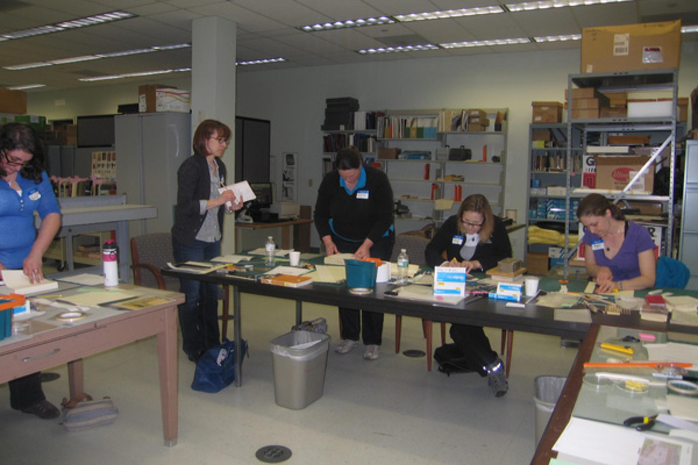 Students use their new knowledge to repair general collections items
