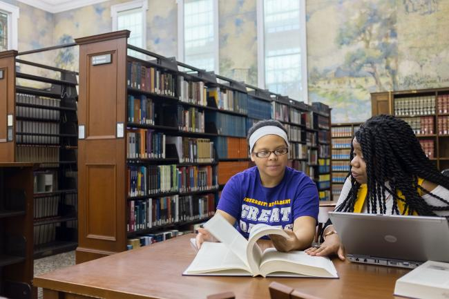 Students use library resources at the Dewey Graduate Library