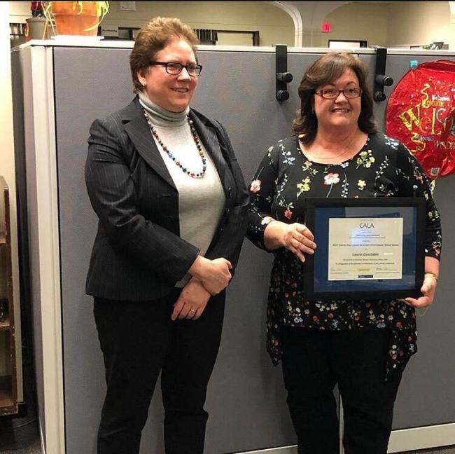 Laurie Constable (right) receives the 2018 Capital Area Library Assistants (CALA) Outstanding Service Awar